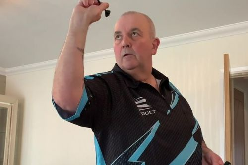 Taylor loses to Van Barneveld in Darts from Home clash which raises £15k for NHS