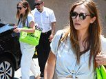 Elizabeth Olsen rocks high-waisted pants and pale white top for InStyle Day Of Indulgence Party