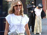 Amanda Holden looks radiant as she struts out of Heart Radio after hosting show