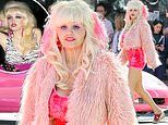 Emmy Rossum is a dead ringer for Angelyne on the set of TV mini series about the LA billboard icon