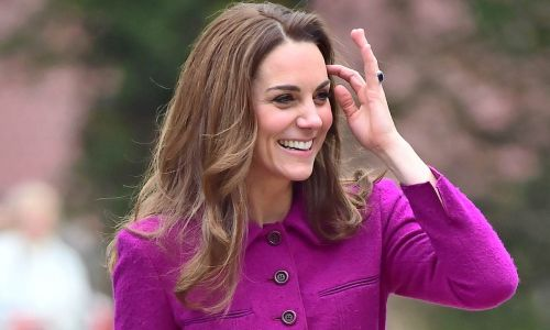 Duchess Kate steps out in Norfolk wearing a purple coat dress and a dreamy Aspinal clutch bag