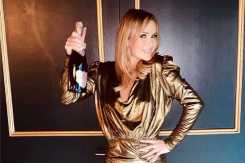 Amanda Holden looks glam for boozy online 'girls night in' with celebrity pals