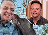 Lisa Armstrong gets huge lick from beloved dog after ex Ant McPartlin hands him over for beach day