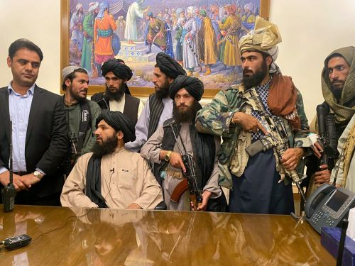 Striking photos and video show Taliban fighters holding guns and reciting from the Quran inside Afghanistan's presidential palace