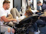 Katie Price and boyfriend Carl Woods get matching tattoos after four month whirlwind romance