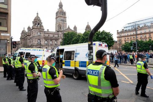 Three men charged over George Square statue protests erupted into violence