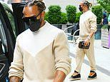 Lewis Hamilton cuts a casual figure in a camel tracksuit as he heads out in New York City