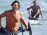 Brody Jenner showcases his bronzed torso as he rides the waves in Malibu