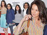 Katie Holmes radiates style and comfort in summery striped blouse and turquoise skirt