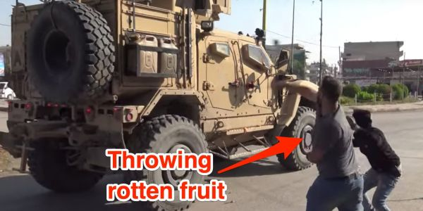 Video appears to show US troops being pelted with stones and rotten fruit as they pull out of Syria