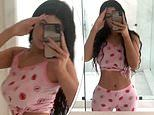 Kylie Jenner shows off her impossibly toned tummy in kiss emoji pajamas as she shares sultry selfies