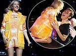 Ellie Goulding commands attention in a VERY garish orange tie-dye ensemble in NYC