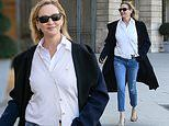 Uma Thurman goes casual in distressed jeans and a chic shirt in Paris