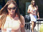 Caitlyn Jenner cuts a sporty look in a skirt and sneakers on a stop for a drink