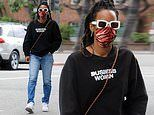 Kelly Rowland looks unrecognizable in dark sunglasses and mask as she dubs herself 'business woman'