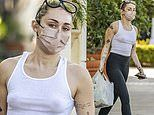 Miley Cyrus leaves little to imagination as she goes braless in white tank top for drug store run