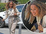 Leona Lewis flashes a smile in LA after Michael Costello responded to claims he 'humiliated' her