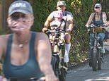 Katy Perry enjoys a bike ride with fiancé Orlando Bloom and their daughter Daisy