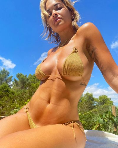 Rita Ora living her absolute best life as she serves up bikini shoot in Ibiza and we're not jealous, you are