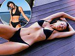 Georgia Fowler flaunts her enviable physique in a racy black bikini while lounging around