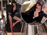 Helena Christensen, 52, puts on a VERY leggy display in a black bodysuit for fashion show at home