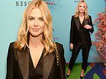 Donna Air cuts a stylish yet sophisticated figure in a tux and waistcoat