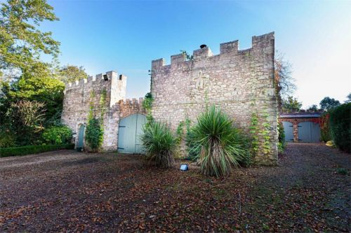 A castle coach house with its own battlement wall is up for sale for £950,000
