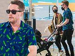 Macaulay Culkin pushes son Dakota in a stroller while picking up groceries with Brenda Song in LA