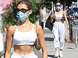 Madison Beer flaunts her impressive abs while rocking a tiny cropped tank top in West Hollywood