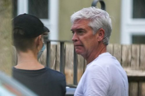 Phillip Schofield inspects damage done to neighbour's car outside bachelor pad