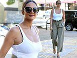 Alesha Dixon displays her post-baby body in a form-fitting white vest top and khaki trousers
