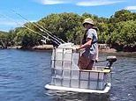 Australian fisherman spotted in a water tank with a motor reeling in a catch