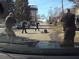Dashcam footage shows moment five police officers fatally shoot armed robbery suspect