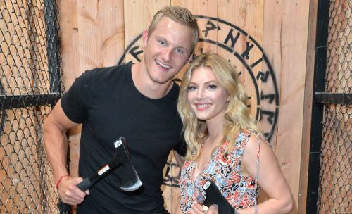 Vikings' Alexander Ludwig and Katheryn Winnick show off their axe throwing skills in epic reunion