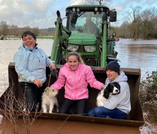 Farmer rescues family from flooding with his tractor loader bucket