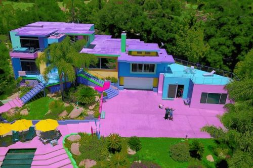 Woman transforms beige home into rainbow paradise - but neighbours hate it