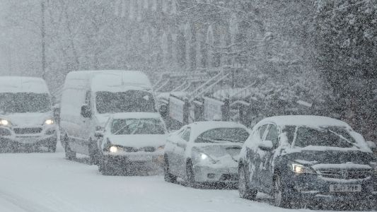 Travel chaos spreads as snow hits England and Wales