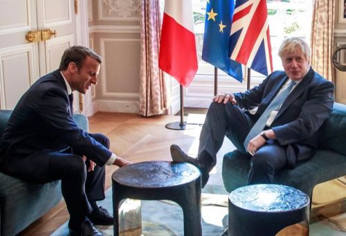 Boris Johnson Puts Foot On Table During Meeting With Emmanuel Macron - And It's All Kicked Off