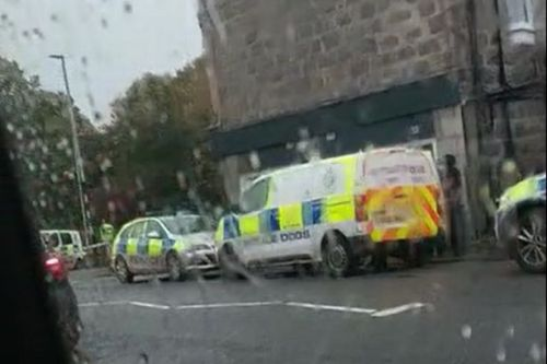 Armed cops dealing with incident in Aberdeen street with emergency services on scene for hours