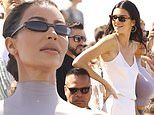 Kim Kardashian flaunts her curves in lilac outfit while Kendall Jenner is angelic in white