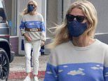 Gwyneth Paltrow sticks to summery chic in sleek white jeans as she steps out for a stroll in LA
