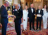 Prince Charles presents fashion designer Ralph Lauren with an honorary KBE at Buckingham Palace