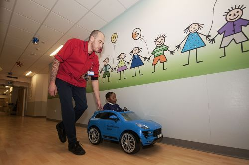 Hospital lets children travel to surgery in mini Porsche to calm nerves