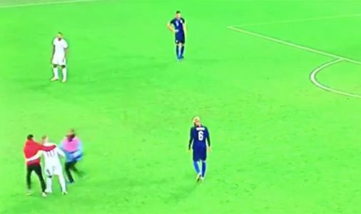 Wayne Rooney confronted by PITCH INVADER during last England game - This is what he did