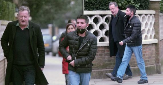 Piers Morgan catches up with Simon Cowell as Britain's Got Talent pals go for lockdown stroll