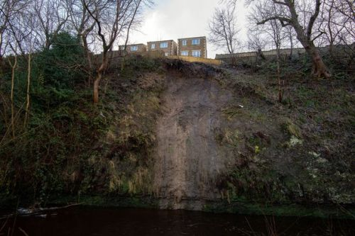 Fears of 'landslip' as house sits on edge of ditch and owners forced to flee