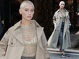Iris Law cuts a stylish figure in Dior trench coat during Paris Fashion Week