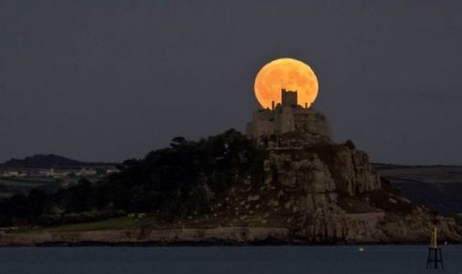 Full Moon in pictures: ENORMOUS Harvest Moon turns skies bright ORANGE in stunning photos