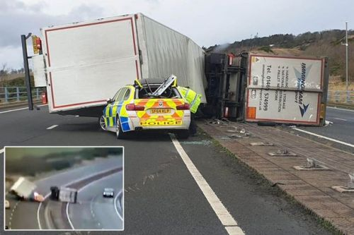Lorry filmed crushing police car after being blown over in strong gale of wind