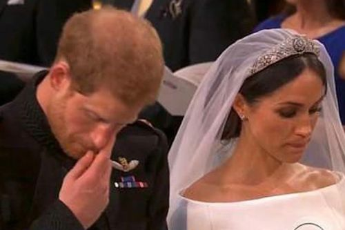 Prince Harry appears to wipe away tear as Princess Diana's favourite hymn is played during royal wedding
